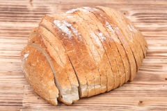Sliced crusty country style round organic french bread Royalty Free Stock Photography