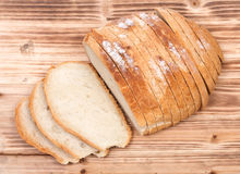 Sliced crusty country style round organic french bread Royalty Free Stock Photo