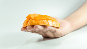 Sliced cube of fresh mango on hand. Piece of Sliced cube of fresh mango on hand. Asian fresh mango on white bachground stock images