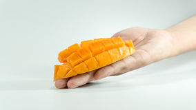 Sliced cube of fresh mango on hand. Piece of Sliced cube of fresh mango on hand. Asian fresh mango on white bachground stock photography