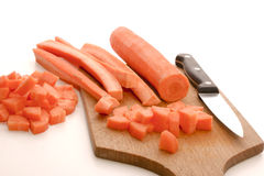 Sliced and cubed carrot. And a white background Royalty Free Stock Photos