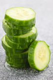 Sliced cucumber. Stack of fresh organic green cucumber slices royalty free stock images