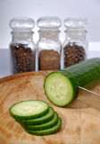 Sliced cucumber. At chopping board stock photos