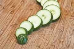 Sliced cucumber close up on cutting board wavy Stock Images