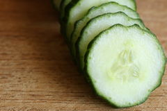 Sliced Cucumber on Cutting Board Stock Photo
