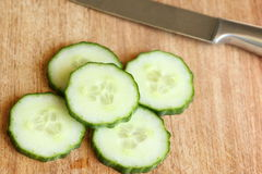 Sliced Cucumber on Cutting Board Royalty Free Stock Image