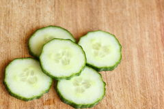 Sliced Cucumber on Cutting Board Royalty Free Stock Photos