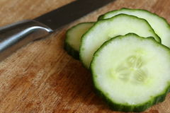 Sliced Cucumber on Cutting Board Royalty Free Stock Photography