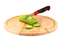 Sliced cucumber on a cutting board Royalty Free Stock Photos