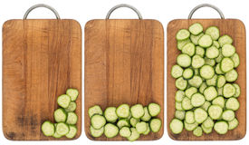 Sliced cucumber on an old cutting board. Royalty Free Stock Photos