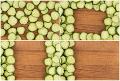 Sliced cucumber on an old cutting board. Royalty Free Stock Photo
