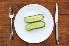 Sliced cucumber on plate Stock Photos