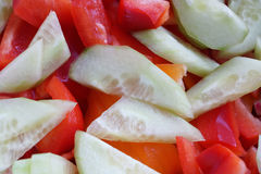 Sliced Cucumber and Red Pepper. Diced red pepper or paprika and cucumbers Royalty Free Stock Photo