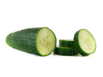 Sliced cucumber with slices isolated on white Stock Images