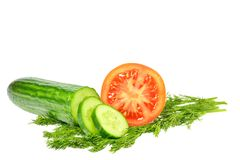 Sliced cucumber into slices next half tomato and dill Stock Photos