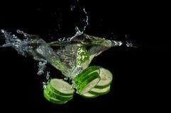 Sliced cucumber splashing water Stock Photography