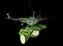 Sliced cucumber splashing water Royalty Free Stock Photography