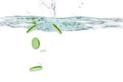 Sliced cucumber splashing water Stock Photos