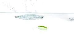 Sliced cucumber splashing water Stock Images