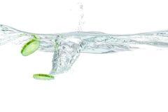 Sliced cucumber splashing water Royalty Free Stock Images