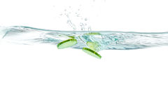 Sliced cucumber splashing water. Healthy and tasty food Stock Photos