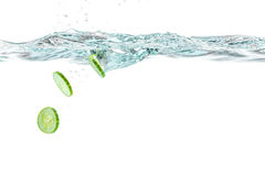 Sliced cucumber splashing water. Healthy and tasty food Stock Image