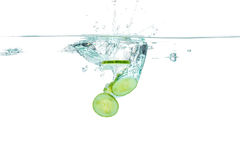 Sliced cucumber splashing water. Healthy and tasty food Royalty Free Stock Images