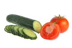 Sliced cucumber and tomatoes isolated on white Stock Photography