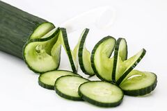 Sliced Cucumber on White Table Stock Image