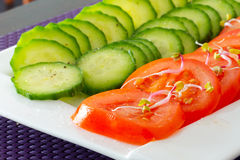 Sliced cucumbers and tomatoes Stock Photos