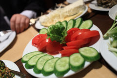 Sliced cucumbers and tomatoes on a plate Royalty Free Stock Photo