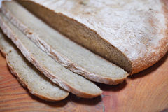 Sliced and cut rye bread, rustic artisan bakery Stock Photography