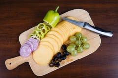 Sliced delicious cheese Stock Photos