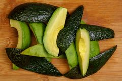 A sliced and diced Avocado with the skin removed and present, st stock images