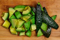 A sliced and diced Avocado with the skin removed and present, st royalty free stock photos