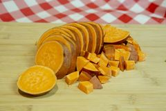 Sliced and diced sweet potato on a cutting board Stock Photography