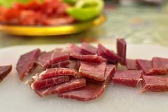 Sliced domestic ham on a kitchen table. Close up shot of sliced domestic ham on a kitchen table stock image