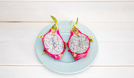 Sliced dragon fruit on plate Stock Photos