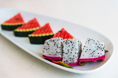 Sliced dragon fruit and watermelon on plate. Selective focus Royalty Free Stock Photos