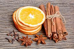 Sliced of dried orange with cinnamon sticks anise and clove on table Stock Images