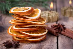 Sliced of dried orange, cinnamon sticks, anise stars and candle with pine brunch Royalty Free Stock Photography