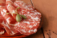 Sliced dried sausage meat (ham, prosciutto, salami) Stock Photography