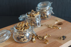 Sliced and dried various mushrooms in three preserving glass bow Stock Photography