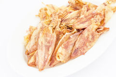 Sliced dry squid in isolate on white. Royalty Free Stock Photos