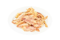 Sliced dry squid in isolate on white. Royalty Free Stock Photo
