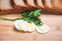 Sliced egg and brown bread Royalty Free Stock Images