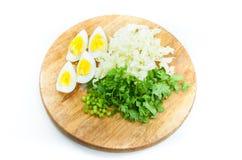 Sliced  egg lettuce Coriander on wooden board Royalty Free Stock Photo