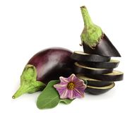 Sliced eggplant or aubergine vegetable with flower isolated on white background.  Stock Photo