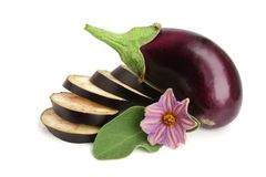 Sliced eggplant or aubergine vegetable with flower isolated on white background stock photos