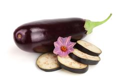 Sliced eggplant or aubergine vegetable with flower isolated on white background.  Royalty Free Stock Photography